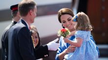 Britain's Kate, the Duchess of Cambridge holds her daughter Princess Charlotte as they arrive at the airport in Berlin, ...