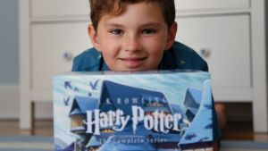 Theo Galkin, 8, poses for a picture with his set of Harry Potter books at his home in South Orange, N.J., Wednesday, ...