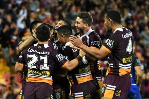 On a roll: Broncos players celebrate one of their many tries on Thursday night.