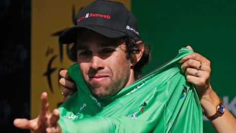 Australia's Michael Matthews putting on the best sprinter's green jersey after the seventeenth stage on Wednesday.
