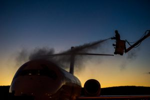 De-iceing work on the Qantas aircraft at Canberra airport in sub-zero temperatures. Photo by Karleen Minney.