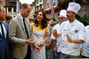 Prince William and the Duchess of Cambridge, listen to explanations by Andreas Goebes, right, of the bakers guild ...
