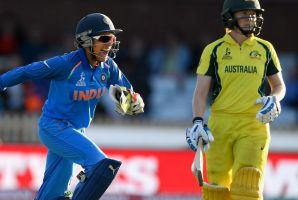 Breakthrough: Indian keeper Sushma Verma celebrates as Alex Blackwell is bowled in the World Cup semi-final.