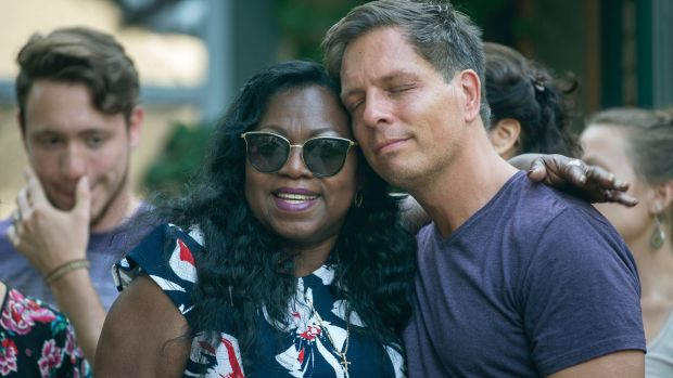 Don Damond, Justine Damond's fiance, is comforted outside his home by Valerie Castile, the mother of Philando Castile.