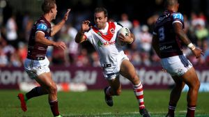 On the move: Jason Nightingale tries to step through the defence.
