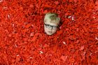 Seven year old Ben MacDonald, submerses himself in Lego during Bricklive in Glasgow, Scotland.