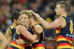 The Crows celebrate a goal in their match with Geelong, which saw them pull clear at the top of the ladder.