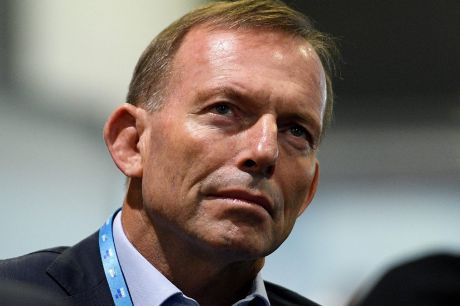 Tony Abbott listens to a speech by Prime Minister Malcolm Turnbull at the Party Futures Convention.