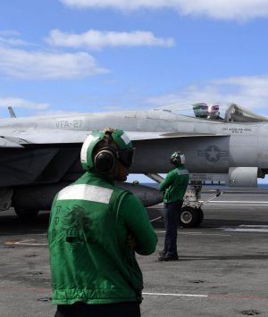 An F/A-18 Super Hornet waits to take off from  the USS Ronald Reagan in the Coral Sea, 650 klm's off the coast from ...