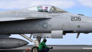 Four steam-powered cable catapults onboard can fire one F/A-18 Super Hornet into the air every minute.