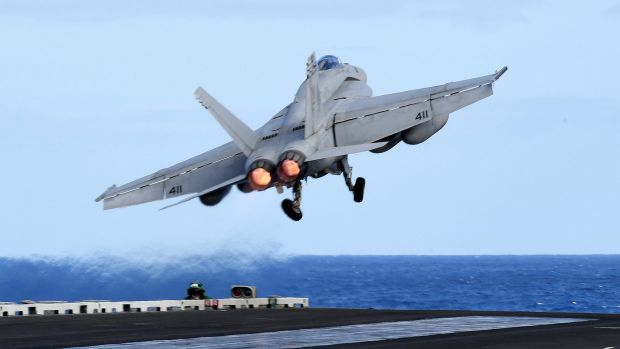 An F/A-18F Super Hornet takes off from the USS Ronald Reagan in the Coral Sea off during the Talisman Sabre military ...
