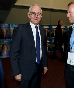 PM Malcolm Turnbull and former prime minister Tony Abbott speak during the NSW Liberal Party Futures conference at ...
