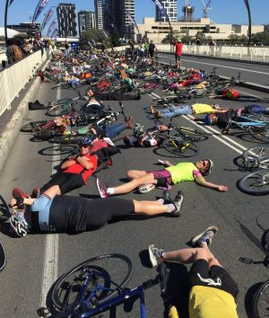Cyclists protest over plans for a shared lane with pedestrians on Victoria Bridge.