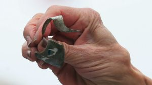 WASHINGTON, DC - JUNE 02: Rep. Jan Schakowsky (D-IL) holds a piece of metal schrapnel from a defective Takata airbag ...