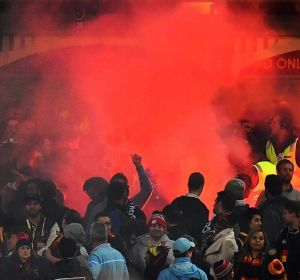 A flare is set off during the match between Adelaide and Geelong on Friday night.