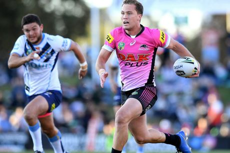 Guts and glory: Matt Moylan winces his way to the line for an unlikely try to the hobbled skipper.