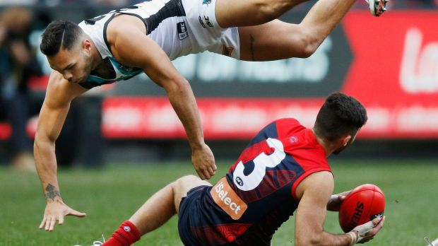 High flyer: Jarman Impey of the Power collides with  Christian Salem of the Demons.
