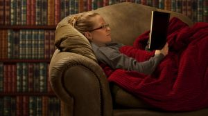 Young Woman Curling Up with a Good Book.