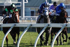 Late charge: Brenton Avdulla, far left, pilots Argent D'or home to a narrow victory at  Randwick.