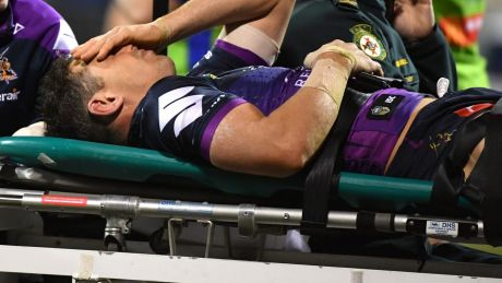Billy Slater is taken from the field after being collected high by Sia Soliola.