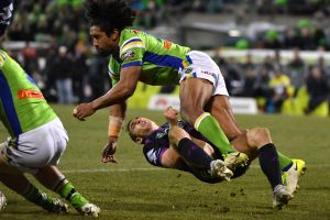 Billy Slater goes to ground after being collected high by Sia Soliola.