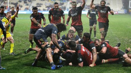 Deluge: Crusaders players celebrate a try in Christchurch.