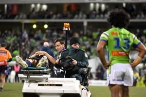 Hit man: Iosia Soliola looks on as Billy Slater is taken from the field.
