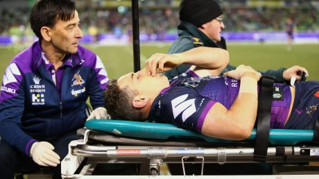 Awful sight: A concussed Billy Slater is assisted from the field.