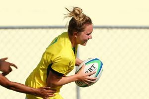 Lilly-Rose Bennett of Australia scores a try during the match between Fiji and Australia in the Girls Rugby Sevens.