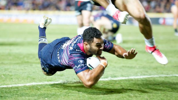Lightning: Justin O'Neill dives over for the Cowboys in Townsville.