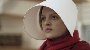 "This image released by Hulu shows Elisabeth Moss as Offred in a scene from, ""The Handmaid's Tale."" Moss was nominated ..."