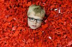 GLASGOW, SCOTLAND - JULY 20: Seven year old Ben MacDonald, submerses himself in Lego during Bricklive at the Scottish ...
