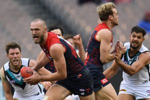 Max Gawn of the Demons (second from left) is seen in action during the Round 18 AFL match against Port Adelaide.