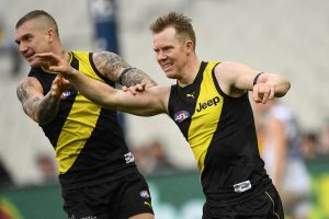 Tiger time: Dustin Martin and Jack Riewoldt. Martin made 11 possessions in the second quarter to lift his side.