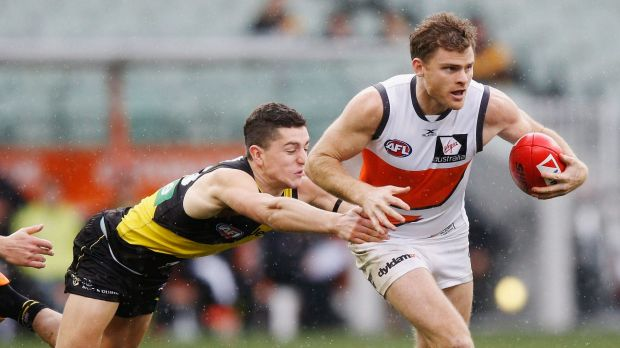 Going nowhere: Richmond's Jason Castagna tackles Heath Shaw.