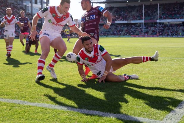 Try time: Timoteo Lafai dots down for the Dragons in their 52-22 win against the Sea Eagles.