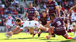 Coming through: Jason Nightingale carves through the Manly defence to score.