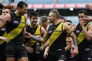 Leaps and bounds: Tigers Toby Nankervis, Trent Cochin, Brandon Ellis and Daniel Rioli after the win over Greater Western ...