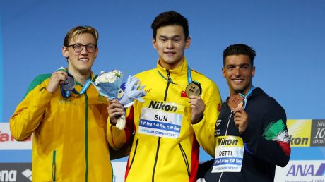 Silver medalist Mack Horton on the podium with gold medalist Yang Sun.