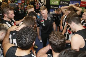 Nathan Buckley addresses his player in the rooms after beating West Coast.