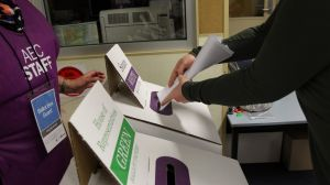 NCH NEWS. 2016 Federal Election. Pic shows a late voter placing her Senate ballot paper in the ballot box at Salt Ash ...