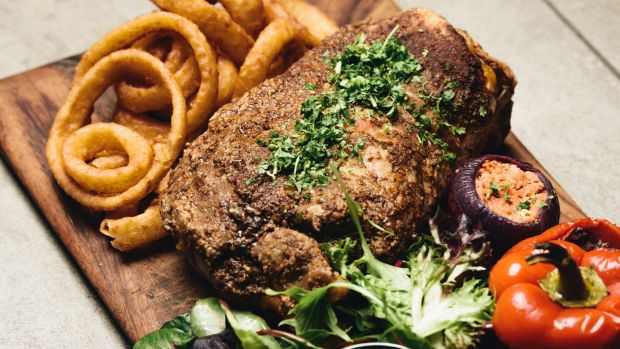 Slow cooked lamb shoulder with a serve of onion rings.