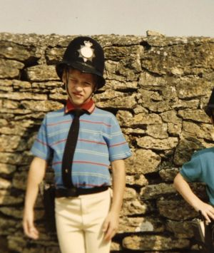 Britain's Prince William, left, and Prince Harry wear policemen outfits in a photo  featured in the new ITV TV ...