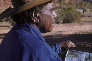 Albert Namatjira painting in the Australian outback.