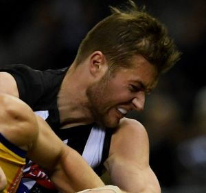 Hard work pays off: Rupert Wills, here tackling Jack Redden, has toiled hard to play his first Pies game for 2017.