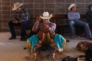 Tyler Turco of Franktown, Colo., warms up his saddle before during the 121st annual Cheyenne Frontier Days Rodeo on ...