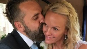 Keith Tyson kisses his new wife, Lis Murdoch, daughter of Rupert Murdoch.