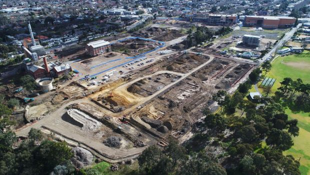 About two-thirds of the Alphington site is being developed, but asbestos concerns may delay the remaining corner, near ...