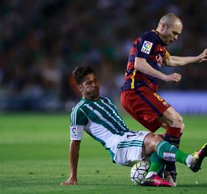 Top class: Western Sydney Wanderers signing Alvaro Cejudo tackles FC Barcelona's Andres Iniesta.