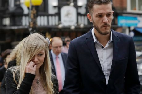 Connie Yates and Chris Gard, parents of critically ill baby Charlie, arrive at the High Court in London.